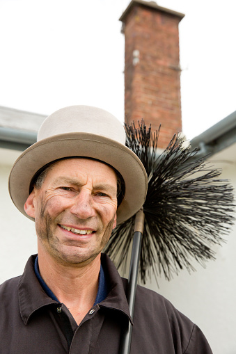 """chimney sweeper"" holding a brush"