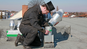 """chimney-sweeper""on roof"